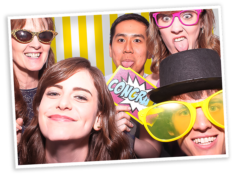wedding with guests enjoying the photo booth hire